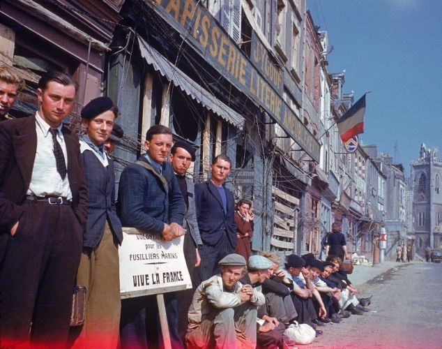 A group of French townspeople gather to welcome the liberating American troops in La Haye-du-Puits, France on Aug. 1, 1944.