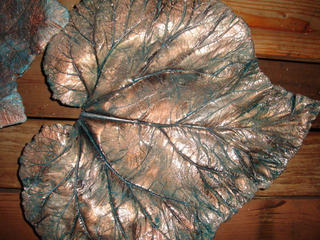 Rhubarb Leaf Stepping Stones - Kitchen Table Forum - GardenWeb - Can use elephant ear caladiums too.