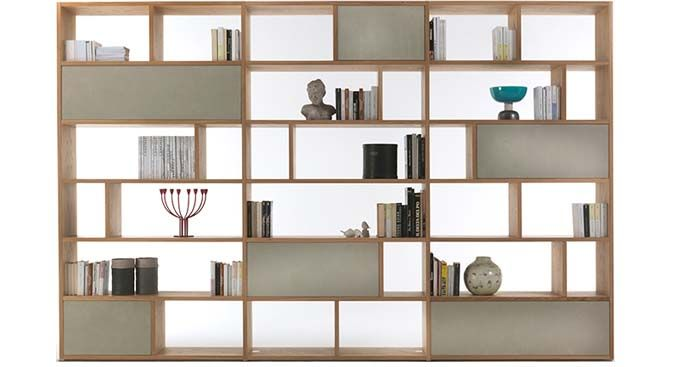 Passwordbookcase isa simple, elegant design, withasymmetricalupright dividers and shelves. Passwordcan be given a personal touch by choosing from a range of elements including drawers and doors with surfaces in wood or concrete effect.