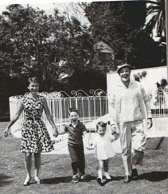 Gene Kelly with wife and children.