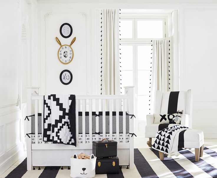 Keep your nursery design elegantly chic with this black and white combo from Emily & Meritt