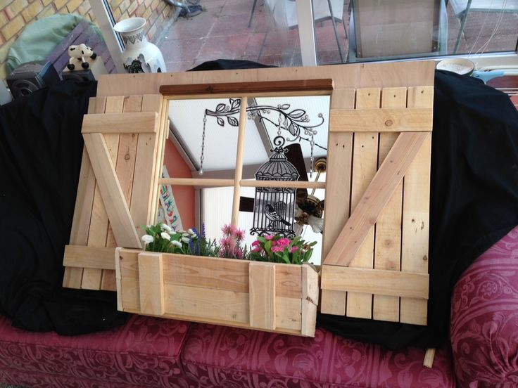 Created from an old pallet - 4 mirror tiles/plants Ikea  and Bird cage Transfer from Cyprus