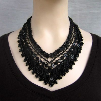 I love the dark delicacy of this beaded thread crochet necklace from NingNingGong.