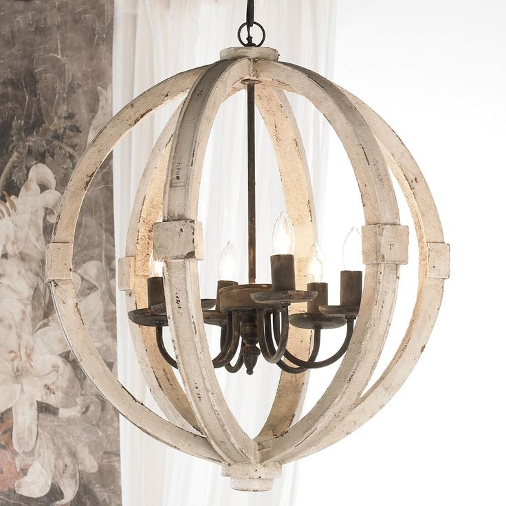 "White Washed Wood Sphere Chandelier Rustic iron and distressed wood go well together in any shape or form and this sphere chandelier is no different. The distressed white washed wood finish and rustic iron accents complement as well as contrast one another. A combination you cannnot go wrong with! 6X40 watt candle base lamps max. (26""Hx22.5""W)"