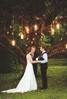 Lanterns hanging from tree wedding altar