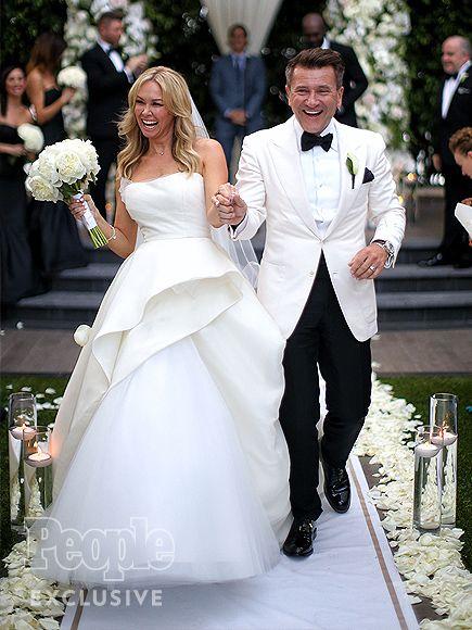 Kym Johnson & Robert Herjavec's Dreamy Wedding Album      They do! Dancing…
