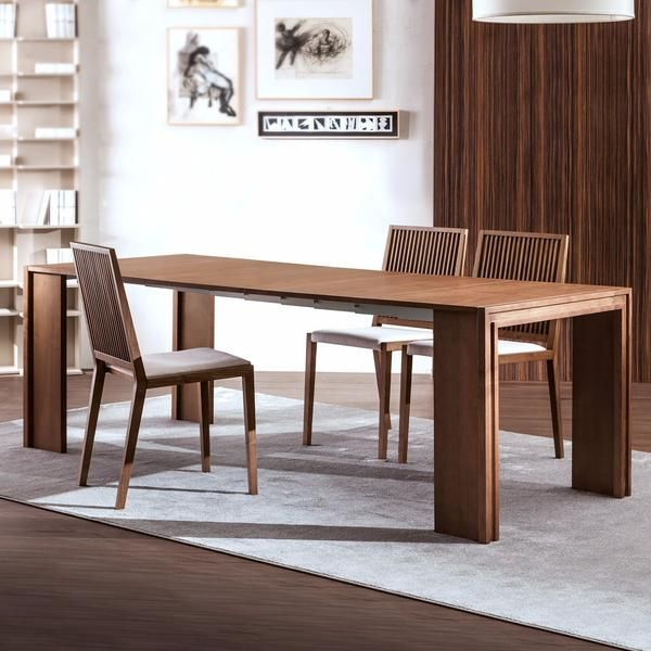 The telescopic Long dining table from Pacini e Cappellini folds into a sleek and compact console table. An ideal dual-purpose solution for small space living.
