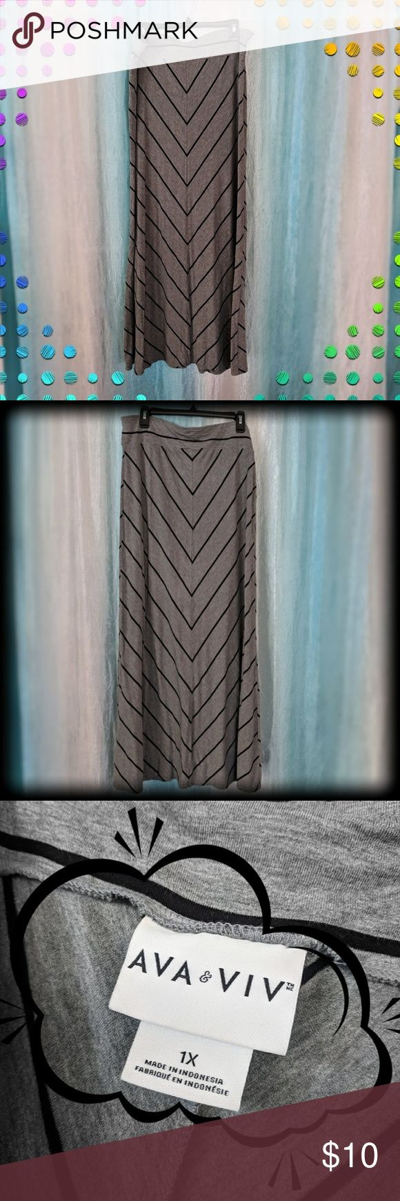 Ava Viv Chevron Maxi Skirt Blk/Grey 1X Maxi skirts are incredibly comfortable, like this A-line maxi from AVA VIV in Grey with Black Chevron stripes and a fabric covered elastic waist band. Depending on height, it falls to the top of the foot or at the ankles. It is previously loved, gently worn and in great shape. There is light pulling in a couple parts of the waist band fabric where it appears to have hung from a hangar.  Please ask questions! Smoke free & dog friendly home. Ava & Viv…