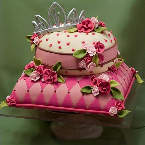 gorgeous pink princess pillow cake with a silver fondant tiara as the wedding cake topper