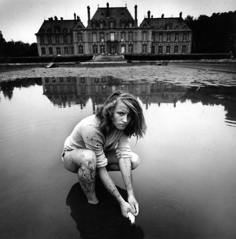 Girl Collecting Gold Fish, France 1974 by Arthur Tress