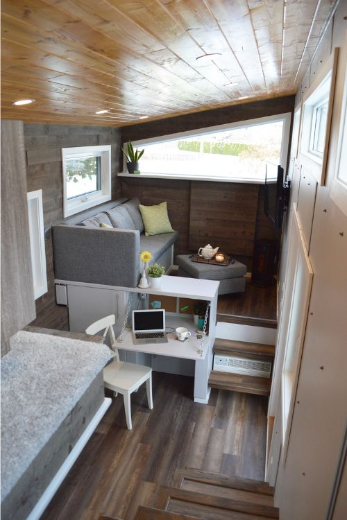 The raised living room has storage space under the floor and a sectional that turns into a guest bed.
