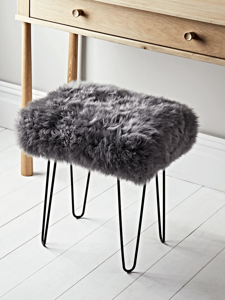 Carefully handmade in the UK, our sheepskin dressing table stool seat cover is crafted from 100% natural long haired sheepskin in a muted slate grey colour. Rectangular in shape, with four black iron hairpin legs to give an industrial twist, this sumptuous stool has an upholstered, padded seat with removable sheepskin. A brush is included for cleaning. Pair with our Bergen Oak Dressing Table to complete a Scandi industrial look.