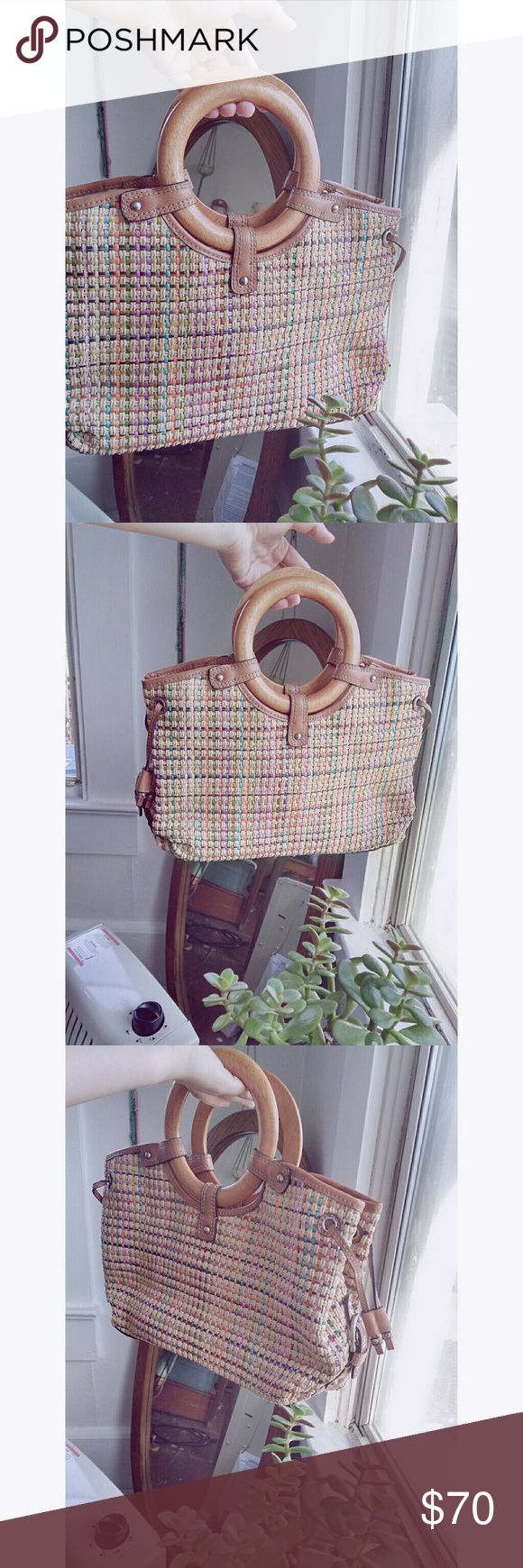 70s Woven Straw Fossil Handbag Super pretty and unique vintage Fossil handbag with a woven rainbow straw exterior, light brown leather, and wooden handles. Exterior is in GREAT condition, only a few spots on the interior. I absolutely love the look of woven straw bags, and this one is really unique and eclectic. The wooden handles are also super cool. 💛✌ Fossil Bags Totes