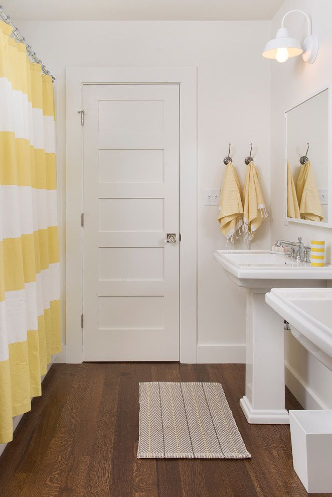 contemporary bathroom with white pedestal sink frameless mirror dark toned wood floors white walls yellow white stripes shower curtain of Great Choices of Fancy Colors for A Small Bathroom