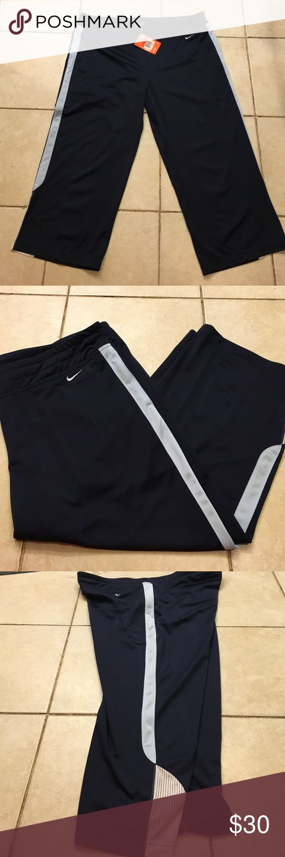 Ladies Workout Pants Nike dark blue with light blue side strip and white bottom 12 / 14 Nike Pants Track Pants & Joggers