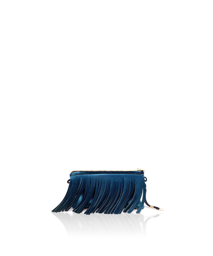 Stand out from the crowd with this fringed clutch. Tough-luxe style with attitude now comes in a range of colours.  Comes with a detachable strap.  Size  290 x 150 x 25 mm  160g  Made in Italy  Vegan Friendly  Made from Velvet  Peacock Blue