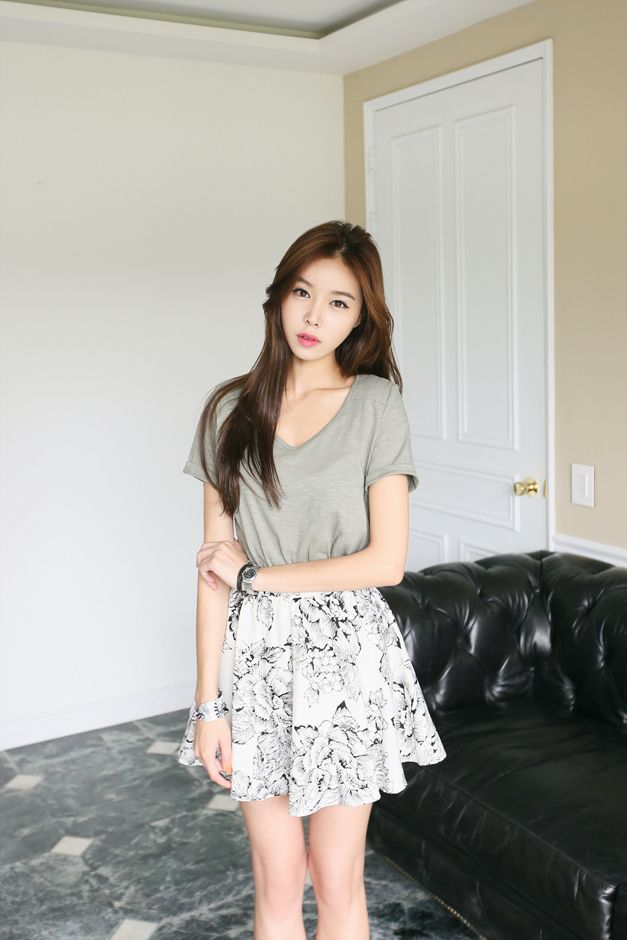 Simple Low Cut Top With A Black And White Floral Patterned