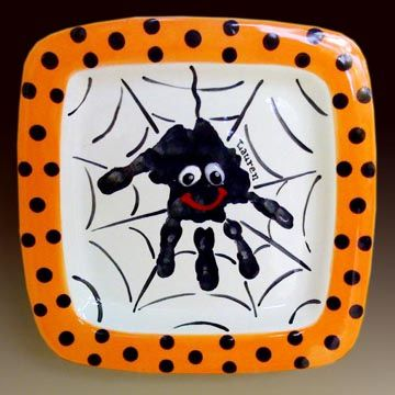 Handprint spider.  Painting on pottery.