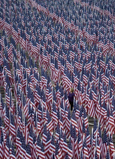 3000 flags line the Pentagon Healing Field where each flag represents a victim of the September 11 attacks, at the September 11 Pentagon Memorial ~ Thursday, Sept. 11, 2008, at the Pentagon in Washington. (AP Photo/Evan Vucci)