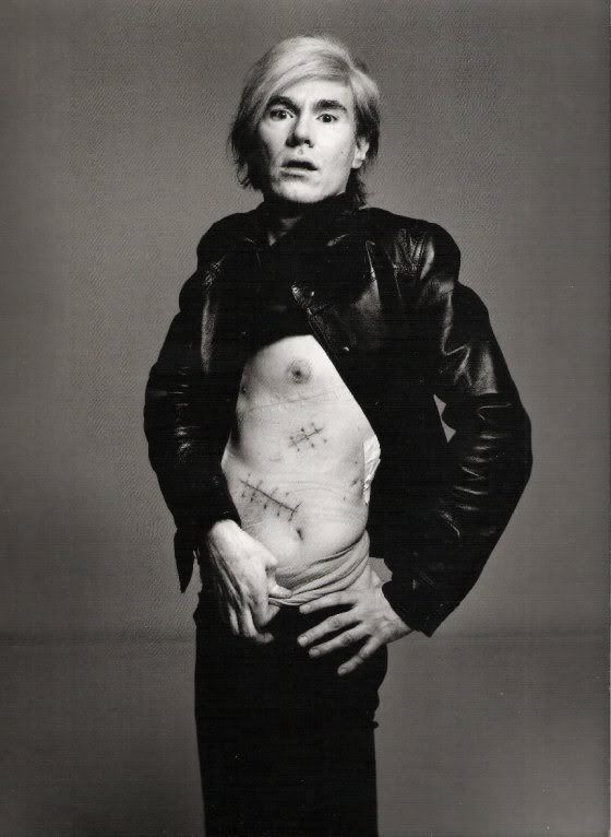 Andy shows his scars - he was shot on June 3, 1968 by Valerie Solanas, the author of the SCUM Manifesto, a separatist attack on men and a marginal member of Warhol's Factory group. Andy barely survived and suffered physical effects for the rest of his life. Art critic Mario Amaya was also shot in the incident and suffered minor injuries.