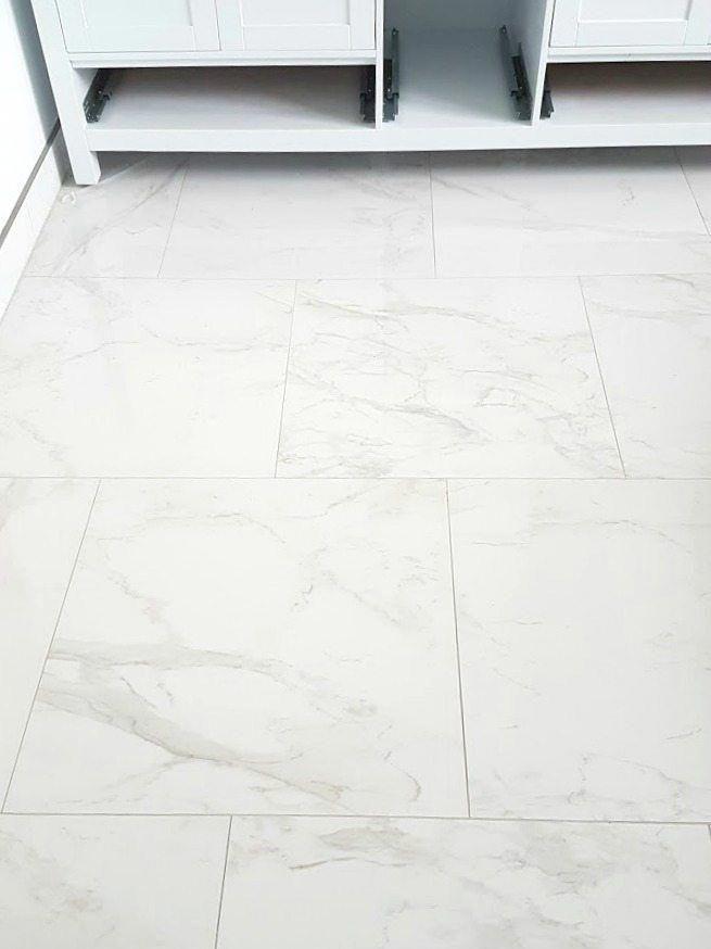 Choosing Faux Carrara Marble Floor Tile For The Bathroom The Sweetest Digs Marble Tile Floor Carrara Marble Floor Marble Bathroom Floor