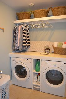 Laundry Room: Front load washer and drying with counter on top and hanging shelf above. With a tv maybe and a table to fold clothes?