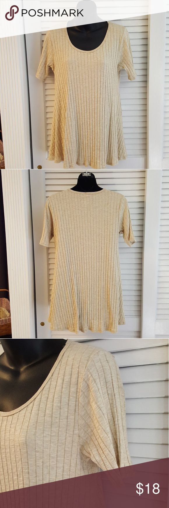 LuLaRoe Short Sleeve Knit Top Size S Pre-Owned LuLaRoe knit top in Size S.  Soft with flexible ribbing, short sleeves and a flowing hemline.  Long length that rests past hips.  Perfect neutral heather beige color.  Great everyday top. Excellent condition. LuLaRoe Tops Tees - Short Sleeve