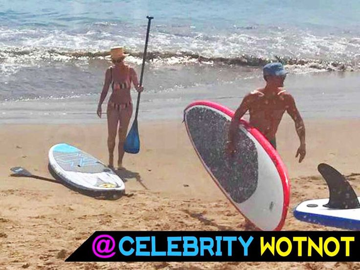 Katy Perry put on a bikini and joined a topless and toned Orlando Bloom on a beach in California to go paddleboarding! © Atlantic Images