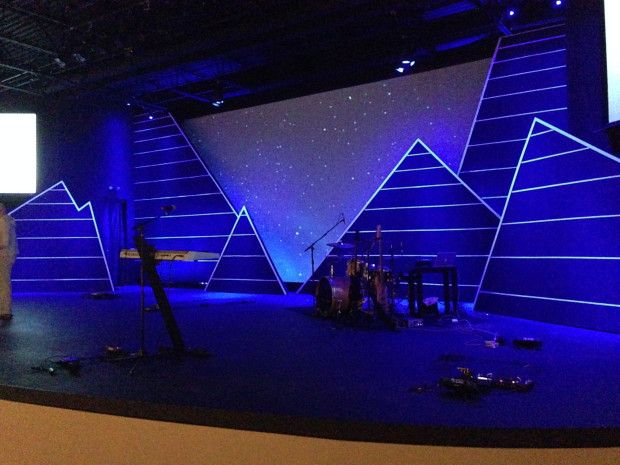 """Jordan Leino from Journey Church in Raleigh, NC brings us this stage design for their series titled """"The Valley""""—about pain and suffering. This was obviously inspired by Hillsong United's """"Welcome Zion"""" set design (see http://www.nathantaylor.co/WELCOME-ZION). I like how it essentially creates a different screen shape out of a standard square screen by simply putting hard set elements in front of the screen. Nice!"""