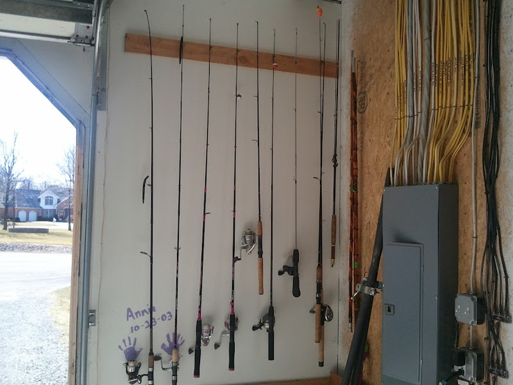 Homemade fishing pole rack diy pinterest fishing for Homemade fishing rod storage ideas
