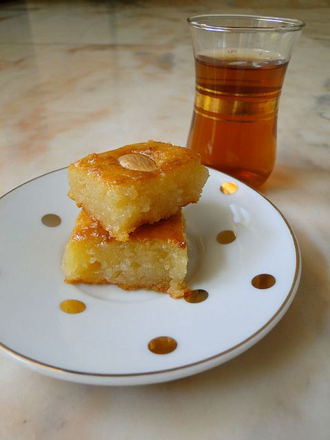 Namoura (lebanese/egyptian/jewish desert)  Ingredients:  2 eggs, lightly beaten  1 cup flour  1 cup semolina  1 cup ground almonds  1 cup butter melted  1 cup whole milk  2 tbsp baking powder  2 tbsp tahini  blanched almonds for decoration    For the syrup:  2 cups castor sugar  2 cups water  1 tbsp Orange blossom water