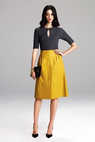Seraphic Secret will lay you odds that Lyn Devon is channeling the late, great actress Suzanne Pleshette. The darts in the skirt make this 50's inspired look totally modern.