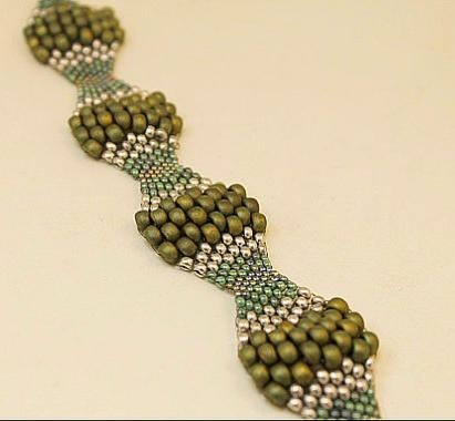 Bracelet stitched with a Unique Artisan Crafted Peyote Pattern / Seed Bead Weaving / Earth Tone / Green / St Patricks Day. $25.95, via Etsy.