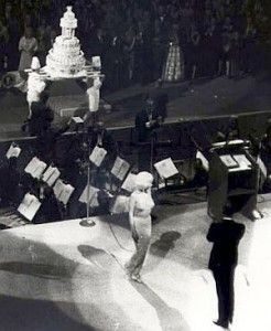 JFK birthday cake being carried into hall as Monroe & Lawford leave stage.  Photo, Life/Bill Ray.