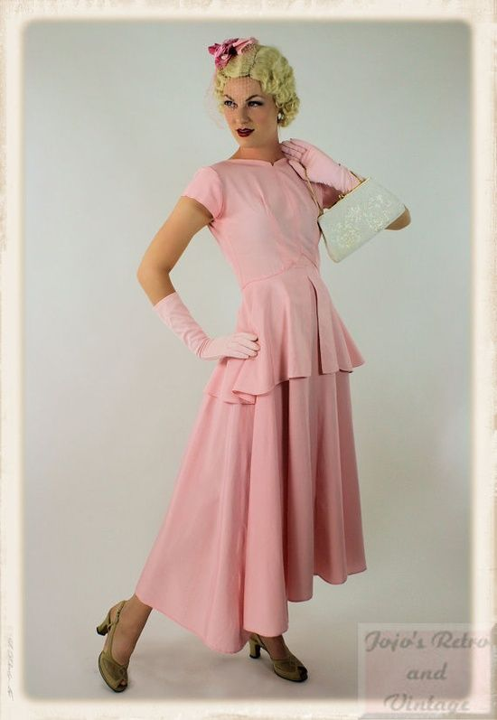 What a marvelously feminine 1940s inspired cotton candy pink hued peplum dress. #dress #pink #vintage #1940s #clothing #fashion #wedding #spring #summer #forties