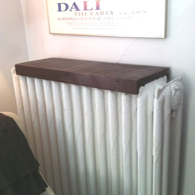 Need to get! Wooden radiator cover shelf, simple and nice looking- plus maximizes space! The dark wood looks nice on the white radiator.