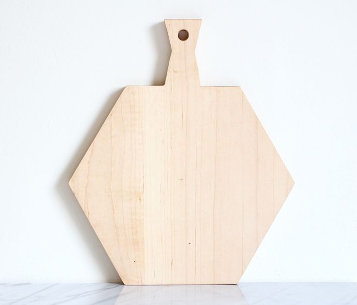 """The HEXA Maple is elegant, perfect for everyday or entertaining.Each board is designed and made by hand in California.  American Maple wood  Surface measures approx. Length 10.5"""" Width12"""" Thick 1"""" Handle 3""""  Each board may vary in color.Care:-Hand wash only-Dry completely-Do not submerge in water-Condition board regularly with mineral oil."""