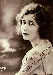"Mildred Harris (November 29, 1901 – July 20, 1944) was an American film actress. Harris began her career in the film industry as a popular child actress at age 11. At the age of 15, she was cast as a harem girl in D. W. Griffith's Intolerance (1916). She appeared as a leading lady through the 1920s but her career slowed with the advent of the ""talkies""."