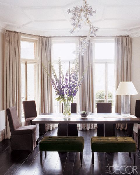 Elegant dining room. I do love the green stools. In the dining room of Nadja Swarovski and husband Rupert Adams's apartment in England, a Dumbo table and Isetta Maxi chairs by Promemoria; the Blossom chandelier is by Tord Boontje for Swarovski.