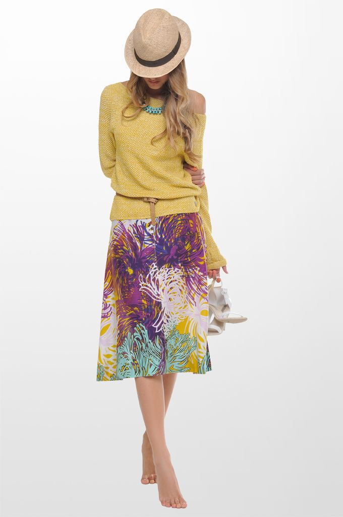 Sarah Lawrence - long sleeve sweater, A line printed skirt, beaded necklace.