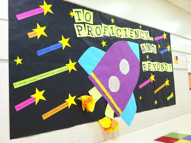 Test Prep Bulletin Board. Read through the blog to get links to printable pages for this board. I would use buzz lightyear on it!