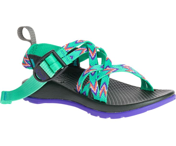 The Chaco Kid's ZX/1 Ecotread sport sandal is a fun sporty sandal with a colorful pattern that's ready for action. This waterproof style offers a completely anatomically contoured footbed with nylon a