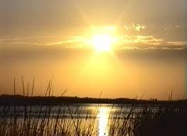 Watch the sun set on Lake Sibaya - the largest fresh water lake in South Africa.