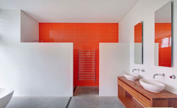 A shower feature wall is a hot trend. Shower panels made of backpainted glass or high gloss acrylic can create an impact!