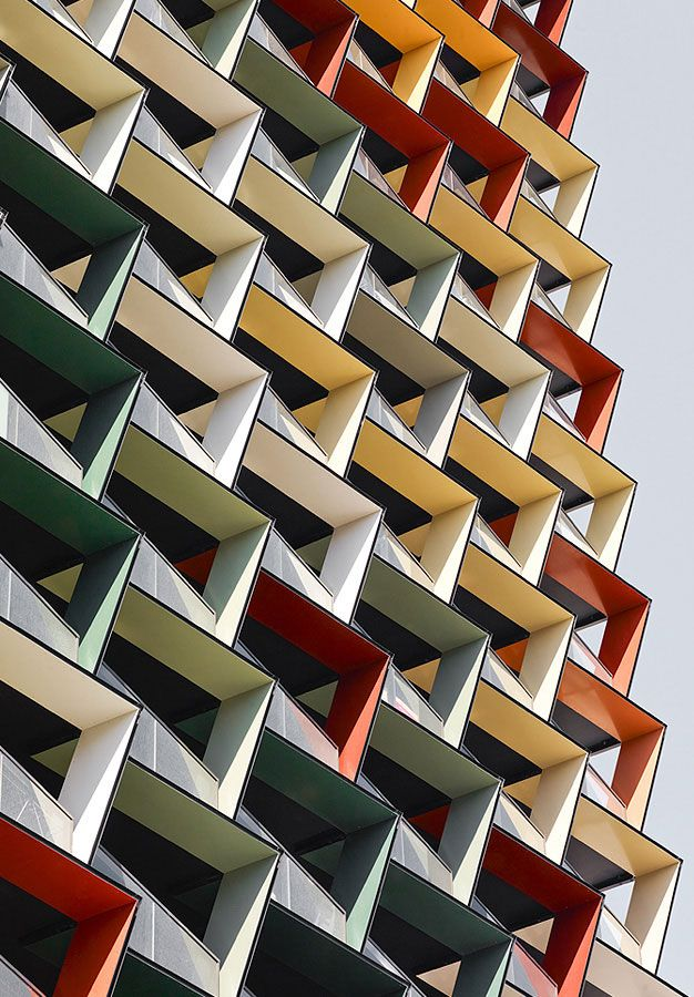 A'Beckett Tower, Melbourne, Australia, by Elenberg Fraser --- 347 sunshade louvers in 16 different colors. The fluidity of the building's alternating color palette is apparent when viewing the louvers at different perspectives.