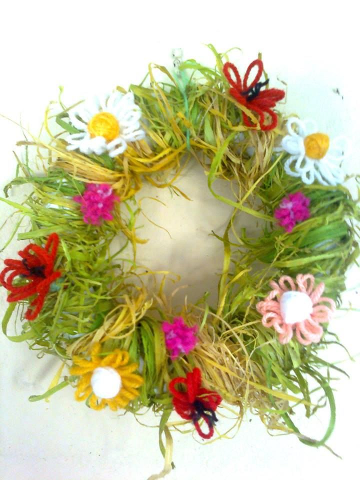 Spring wreath with wool flowers