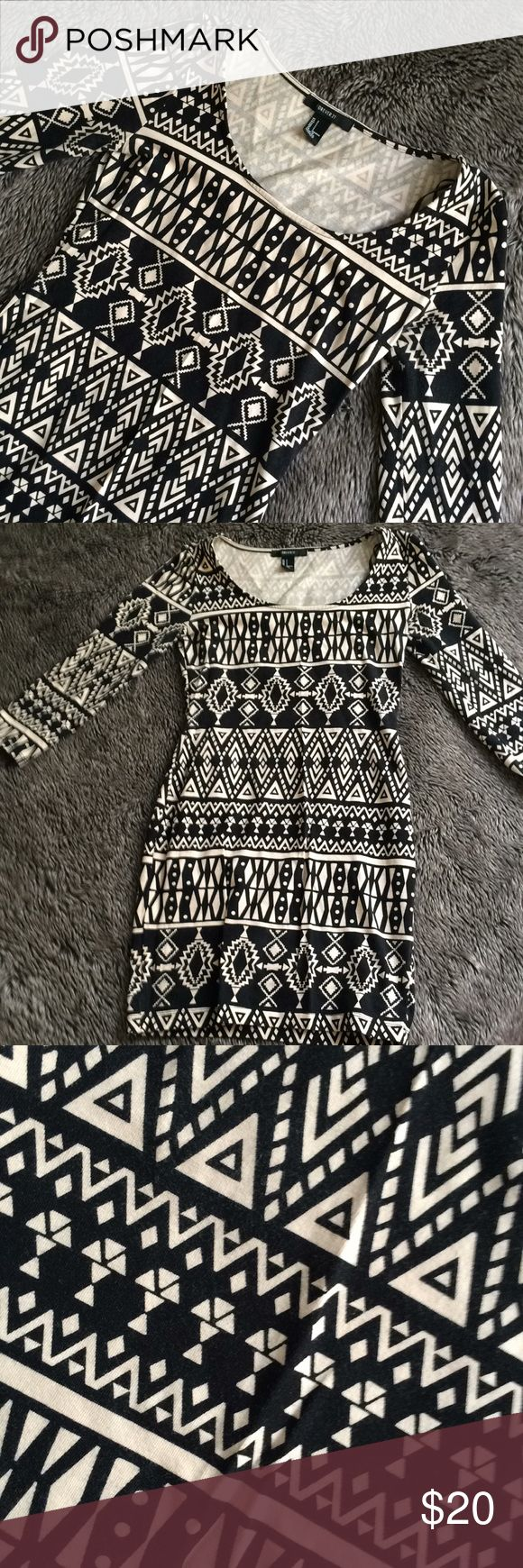 Aztec Mini dress Forever 21 Aztec pattern mini dress. Gorgeous! Worn once! Super comfortable and stretchy material. Neckline is very flattering yet modest and allows wear with all types of necklace lengths. Great alone with a pump or tucked into a skirt. One of my favorites! Forever 21 Dresses Mini