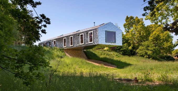 "20 OF THE WORLD'S MOST WONDERFULLY QUIRKY PLACES TO STAY #2. The Balancing Barn. This rustic yet super modern barn ""dramatically cantilevers over the landscape,"" and features panoramic views over woods, ponds and meadows. Vertigo not included."