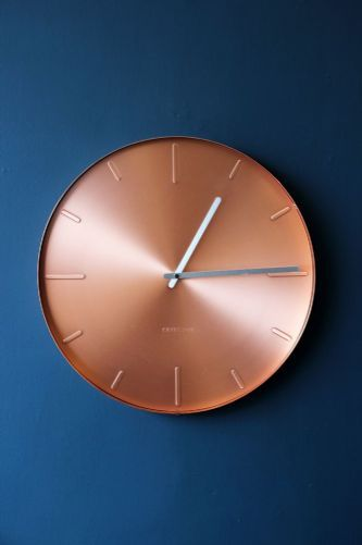 Stunning copper clock - it works so well on this deep blue wall.