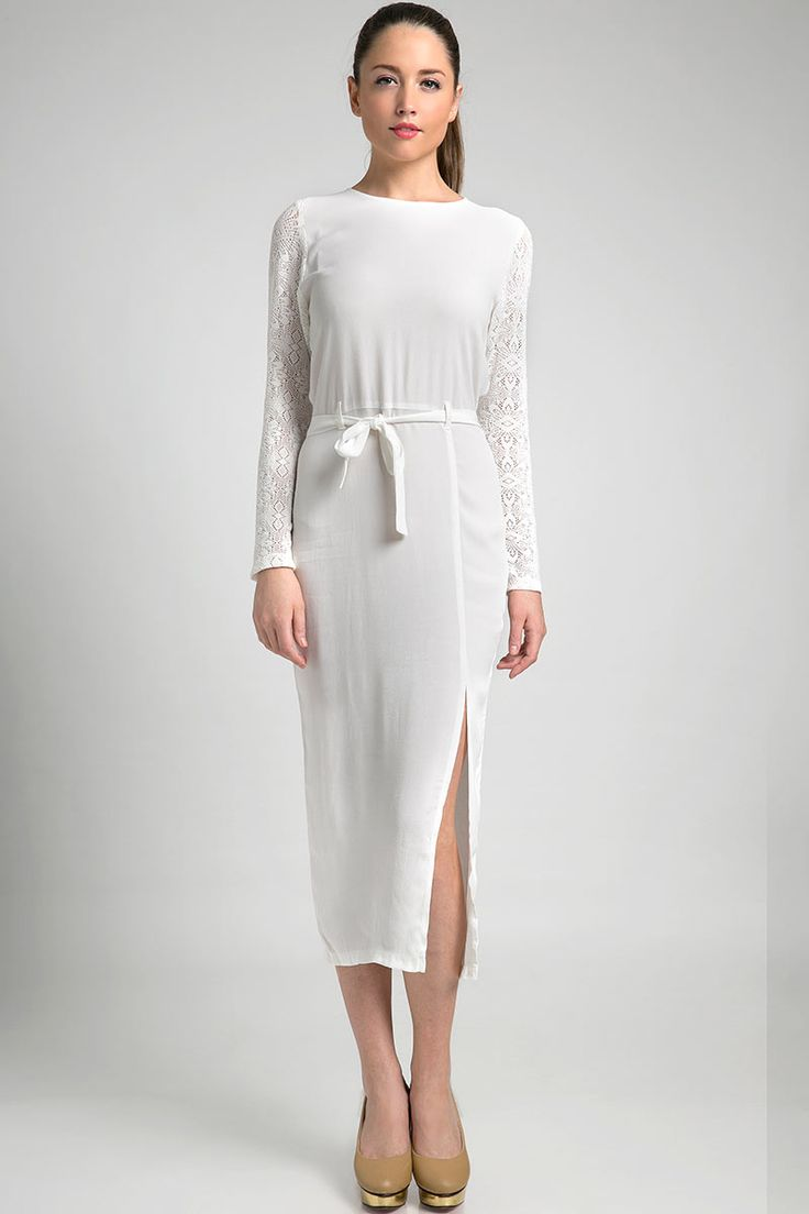 Tarra Dress Midi dress with slit by Stratto. It has long sleeves that is made from intricate lace fabric. The white color makes the dress looks very classy for an elegant evening.   http://zocko.it/LERuG